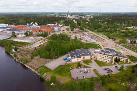 Aerial panoramic view of factory in city Inkeroinen at river Kymijoki, Finland.