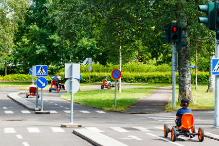 Traffic educational experience - practice park for children. Mini car road, traffic sign and traffic light Stock fotó