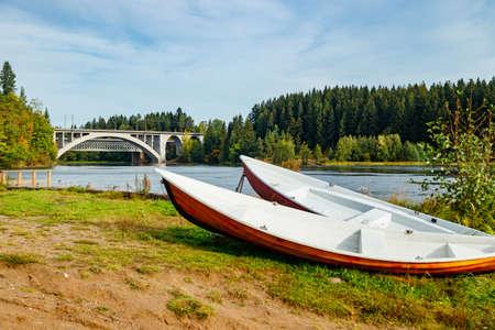 Autumn landscape of bridge and boats on Kymijoki river in Finland, Kouvola, Koria Stock fotó