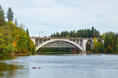 Autumn landscape of bridge and Kymijoki river waters in Finland, Kouvola, Koria