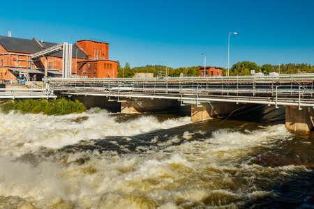 Rough waters of bypass on rapids Kuusankoski, Finland