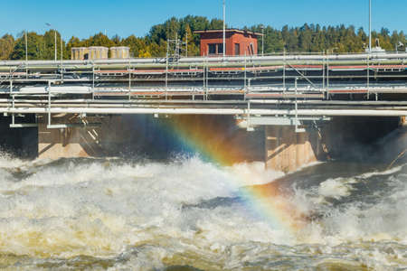 Beautiful rainbow on bypass at rapids Kuusankoski, Finland 版權商用圖片