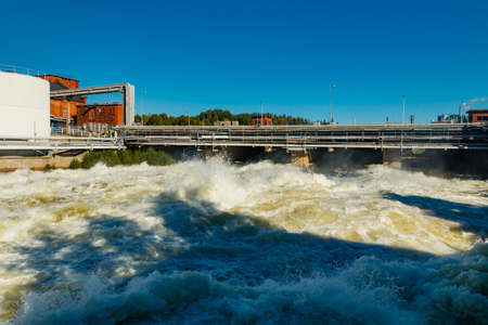 Rough waters of bypass on rapids Kuusankoski, Finland