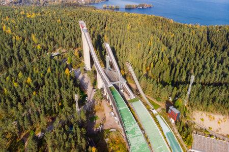 Aerial view of Lahti sports center with three ski jump towers. 免版税图像