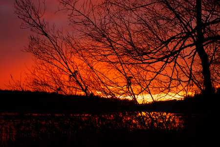 Beautiful sunset in November on the lake, Finland.