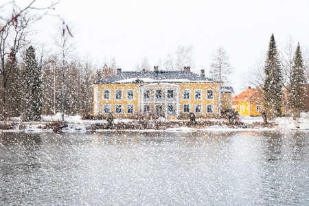 KOUVOLA, FINLAND - MARCH 21, 2019: Beautiful wooden Rabbelugn Manor - Takamaan Kartano. Wrede family house was built in 1820 on the river Kymijoki bank.