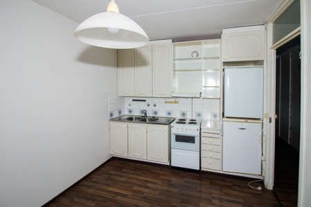 Interior of empty old kitchen in an apartment studio