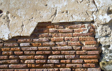 The facade view of the old brick wall for design background.