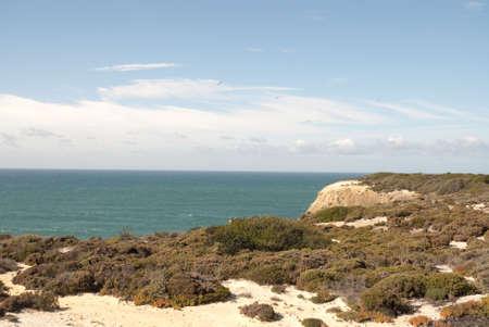 Magnific Cliffs of Portugal in Atlantic ocean Stock Photo