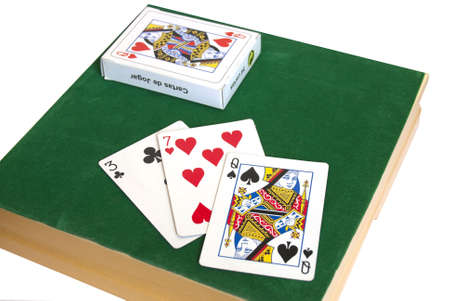 Game of the cards on the green background Editorial