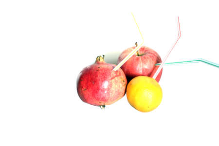 Tangerine ,apple and pomegranate isolated on the white background