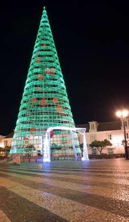 Christmas and New Year illumination tree on the street at night