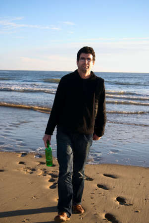 A man with bottle at Atlantic ocean Stock Photo - 6273863