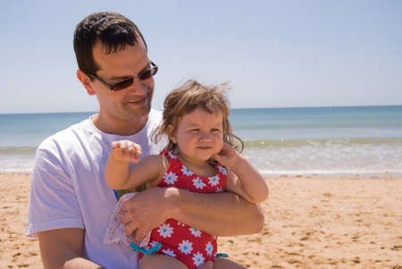 Dad and daughter spending a day at the beach