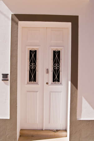 view of a wooden doorway: Door of a traditional house - Algarve , Portugal Stock Photo