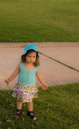 The little girl play in park Stock Photo