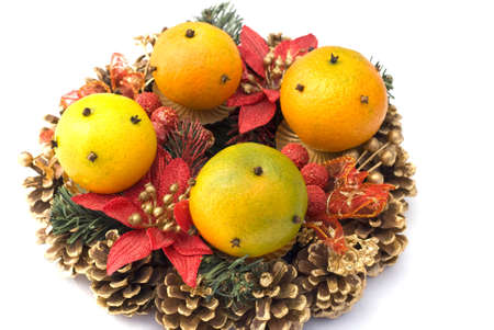 The christmas wreath with oranges isolated photo