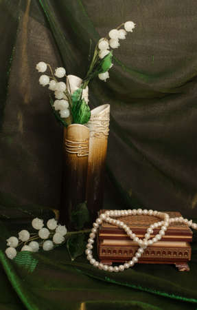 White flowers and pearls neacklace Stock Photo