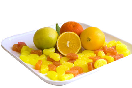 Oranges fruits and candies isolated on white