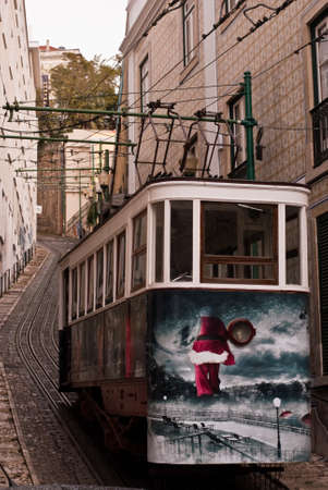 Tram in a street of lisbon in autumn Editorial