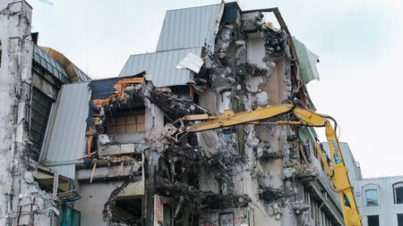 Excavator destroys the old building, timelapse. Demotazh old house. Reklamní fotografie