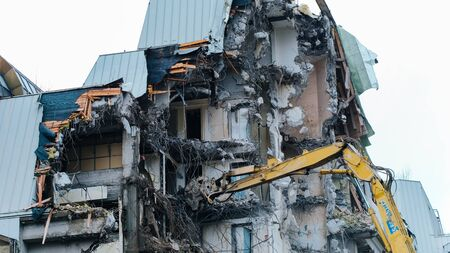 Demolition of an old building, time-lapse. Excavator destroys old building Reklamní fotografie
