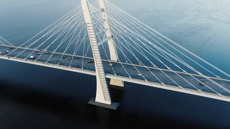 flycam shows modern cable-stayed bridge with pylons and cars Reklamní fotografie