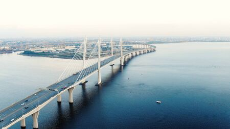 flycam moves above long cable-stayed bridge with pylons Reklamní fotografie