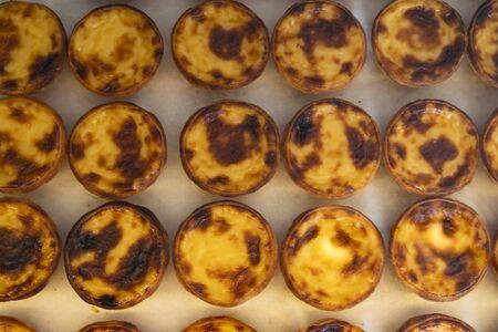 Portugese pastries - pasteis de nata. Delicious home made cuisine. Typical for Lisbon region. Banco de Imagens