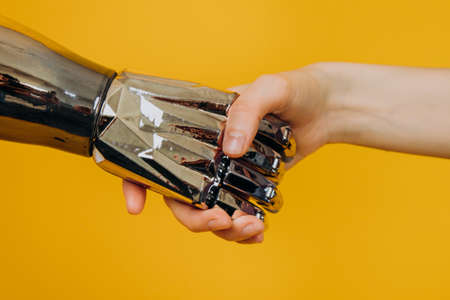 Injured person with bionic prosthesis joins hands with woman
