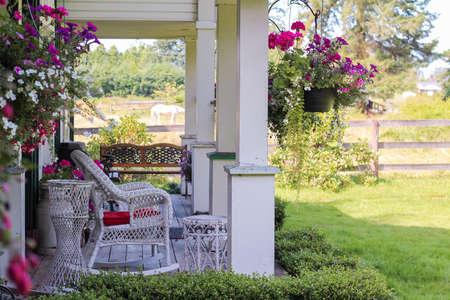 Beautiful decorative gazebo terrace with flowers in a countryside. Selective focus, travel photo, street photo, nobody. Stockfoto