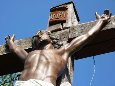 Jesus on a wood cross photo