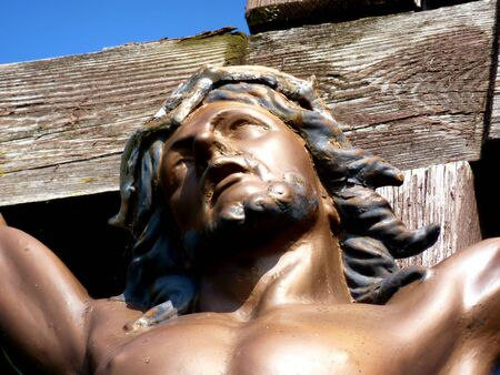Close up of Jesus face on the cross photo