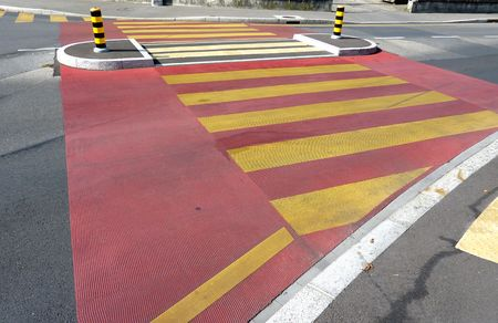 Red and yellow pedestrian crossing photo