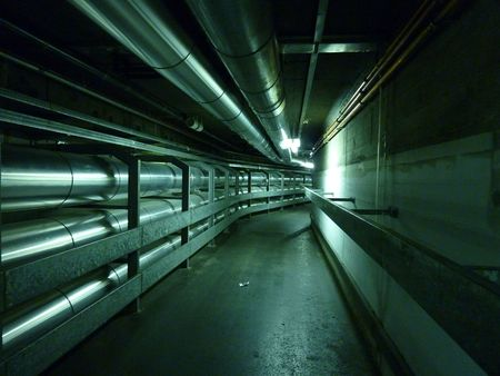 Underground tunnel with metallic pipes photo