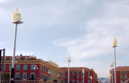 White men statues and red buildings at the place Massena, Nice, France, by beautiful weather photo