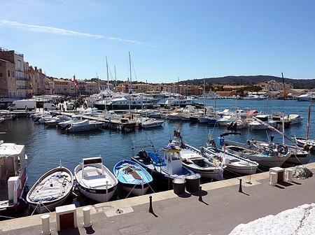 Yachts and small boats at Saint-Tropezs port, south of France, with buildings behind by beautiful weather photo