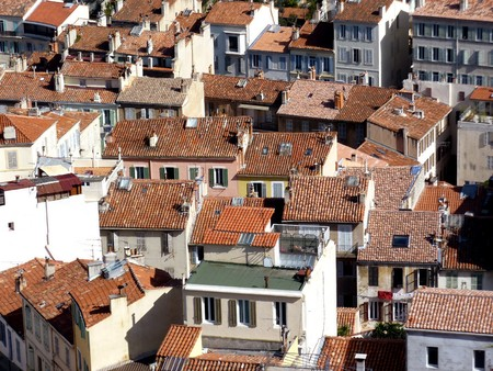 Aerial view of many red roofs at Marseilles, France, by sunny day