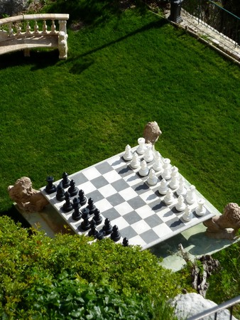 Big chess game in a beautiful green private garden photo