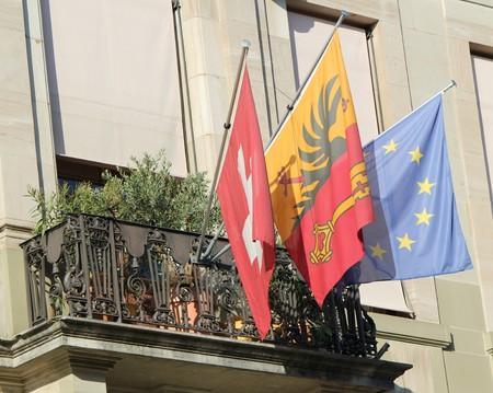 canton: Flags of Geneva canton, Switzerland and Europe on a balcony