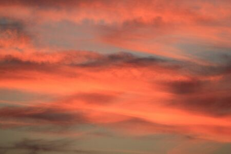 Red and orange cloudy sky by sunset