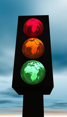 Black traffic light with red, orange and green earth as colors Stock Photo