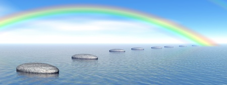 Grey stones steps upon the ocean going to a beautiful rainbow photo