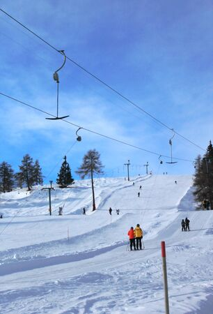 People using ski tow in the winter Alps mountain by beautiful weather, Switzerland photo