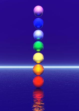 chakras: Bolas de colores para una columna de chakra en fondo azul Foto de archivo