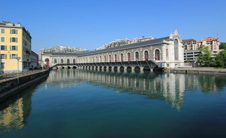 Famous batiment des Forces-Motrices on the Rhone river, Geneva, Switzerland  Stock Photo