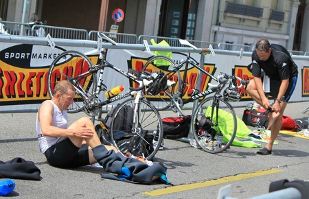 Cyclists changing clothes to go biking at the International Triathlon 2011, Geneva, Switzerland