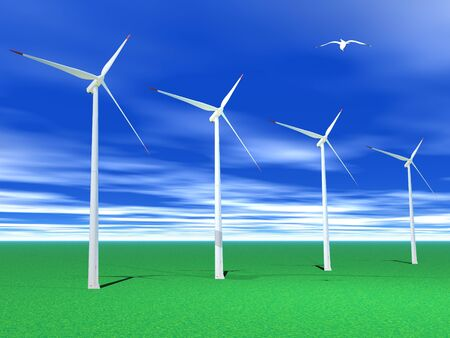 Bird flying over four white and red wind turbines in green grass by beautiful weather photo
