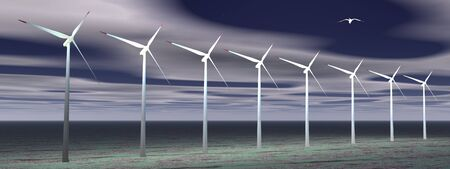 Bird flying over wind turbines by cloudy night Stock Photo - 10102869