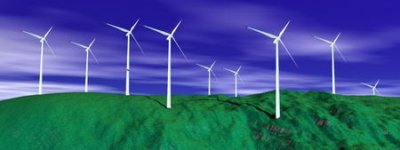 windfarm: Wind turbines on a green hill with deep blue cloudy sky Stock Photo